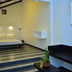 Отель Midigama Holiday Inn 3* Номер Делюкс с различными типами кроватей фото 15