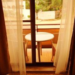 Отель L'Orchidee Hotel Республика Конго, Пойнт-Нуар - отзывы, цены и фото номеров - забронировать отель L'Orchidee Hotel онлайн балкон