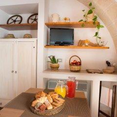 Отель Grandi Trulli Bed & Breakfast Альберобелло в номере