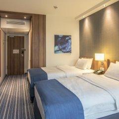 Отель Holiday Inn Express Dusseldorf - City 3* Стандартный семейный номер с двуспальной кроватью фото 5