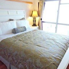 Апартаменты Umi No Mieru Apartment Центр Окинавы комната для гостей фото 2