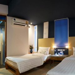 Отель Uncle Loy's Boutique House Таиланд, Бангкок - отзывы, цены и фото номеров - забронировать отель Uncle Loy's Boutique House онлайн комната для гостей фото 4