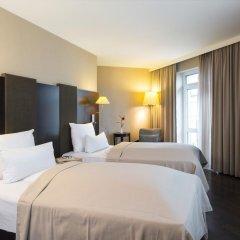 Отель NH Düsseldorf Königsallee 4* Улучшенный номер с различными типами кроватей