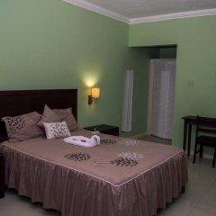 Отель Donway, A Jamaican Style Village Ямайка, Монтего-Бей - отзывы, цены и фото номеров - забронировать отель Donway, A Jamaican Style Village онлайн комната для гостей фото 5