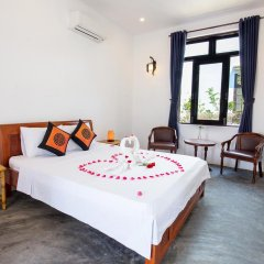 Отель An Bang Sunrise Beach Bungalow комната для гостей