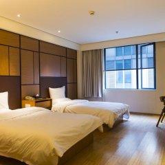 Отель JI Hotel Xi'an Giant Wild Goose Pagoda East Xiaozhai Road Китай, Сиань - отзывы, цены и фото номеров - забронировать отель JI Hotel Xi'an Giant Wild Goose Pagoda East Xiaozhai Road онлайн комната для гостей фото 5