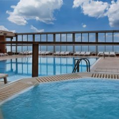 Отель Crowne Plaza Tel Aviv Beach бассейн фото 2