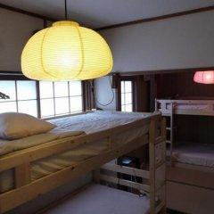 Отель Tabicolle Backpackers Кровать в женском общем номере фото 15