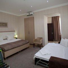 Отель Rustaveli Palace Стандартный семейный номер с двуспальной кроватью фото 31