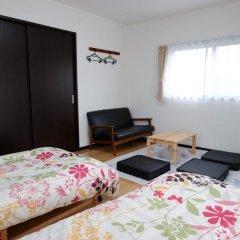 Отель Cottage Kutsuroki Япония, Якусима - отзывы, цены и фото номеров - забронировать отель Cottage Kutsuroki онлайн комната для гостей фото 4