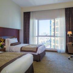 Отель Grand Millennium Al Wahda 5* Улучшенный номер с различными типами кроватей фото 5