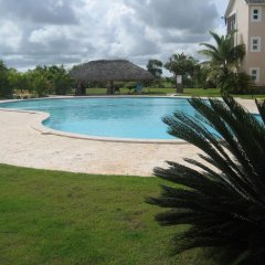 Отель Laguna Golf Доминикана, Пунта Кана - отзывы, цены и фото номеров - забронировать отель Laguna Golf онлайн бассейн фото 2