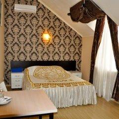 Гостиница Ростов Улучшенный номер двуспальная кровать фото 5