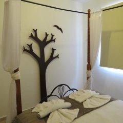 Отель Melania Gardens сейф в номере