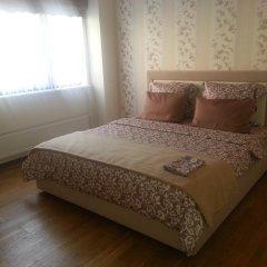 Отель Mindaugo Apartment 23A Литва, Вильнюс - отзывы, цены и фото номеров - забронировать отель Mindaugo Apartment 23A онлайн комната для гостей