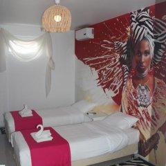 Гостевой Дом Жемчужинка Студия разные типы кроватей фото 10