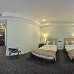Отель Амбассадор 4* Стандартный семейный номер с двуспальной кроватью фото 11