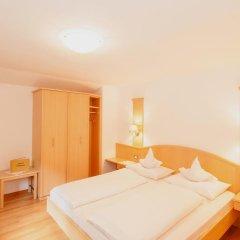 Отель Appartements Kirchtalhof Лана комната для гостей