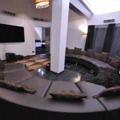 Апартаменты Греческие Апартаменты комната для гостей фото 5
