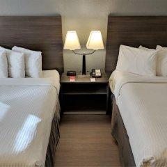Отель Econo Lodge South Calgary Канада, Калгари - отзывы, цены и фото номеров - забронировать отель Econo Lodge South Calgary онлайн комната для гостей фото 4