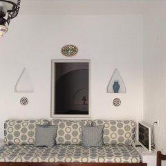 Nikos Villas Hotel in Oia Santorini удобства в номере фото 2