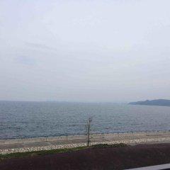 Отель ONSENKAKU Беппу пляж
