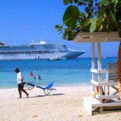 Отель Beach-side condos at Turtle Beach Towers пляж фото 2