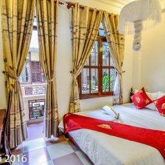 Отель Nhi Nhi 3* Номер Делюкс фото 13
