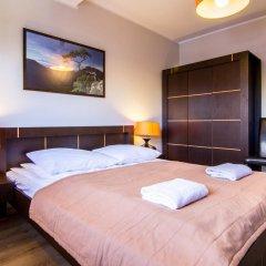 Отель Apartamenty Snowbird Zakopane Косцелиско комната для гостей фото 3