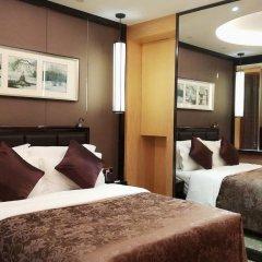 Отель Zhongshan Tegao Business Hotel Китай, Чжуншань - отзывы, цены и фото номеров - забронировать отель Zhongshan Tegao Business Hotel онлайн комната для гостей фото 2
