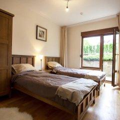 Отель Pirin Lodge Apt 37 Банско комната для гостей фото 3