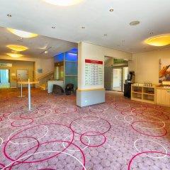 Отель Leonardo Royal Hotel Köln - Am Stadtwald Германия, Кёльн - 8 отзывов об отеле, цены и фото номеров - забронировать отель Leonardo Royal Hotel Köln - Am Stadtwald онлайн интерьер отеля