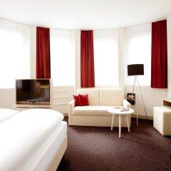 Отель Vienna House Easy München 4* Стандартный номер с различными типами кроватей фото 4