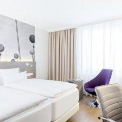 Отель NH Collection Berlin Mitte Am Checkpoint Charlie 4* Улучшенный номер с разными типами кроватей фото 2