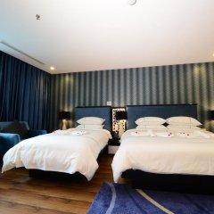 Hanoi Emerald Waters Hotel & Spa 4* Стандартный семейный номер с двуспальной кроватью фото 7