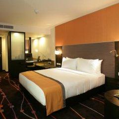 Отель Radisson Suites Bangkok Sukhumvit Бангкок комната для гостей фото 2