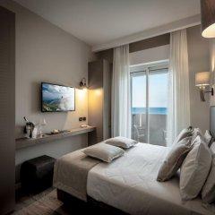 Отель Suite Litoraneo Римини комната для гостей