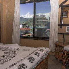 Отель Peace Eye Guest House Непал, Покхара - отзывы, цены и фото номеров - забронировать отель Peace Eye Guest House онлайн комната для гостей фото 2