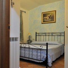 Отель La Casa Rosa Кастаньето-Кардуччи в номере