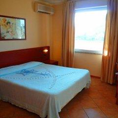 Отель Residence Miralago Rooms & Apartments Италия, Манерба-дель-Гарда - отзывы, цены и фото номеров - забронировать отель Residence Miralago Rooms & Apartments онлайн комната для гостей фото 2