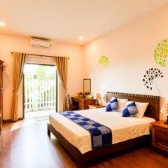 Отель Tra Que Riverside Homestay 2* Улучшенный номер с различными типами кроватей фото 3