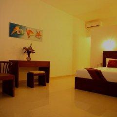 Whispering Palms Hotel 3* Номер Делюкс фото 5