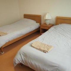 Отель Pension Sky View Якусима комната для гостей фото 3