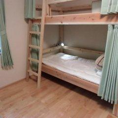 Отель Guesthouse Yakushima 2* Кровать в женском общем номере фото 2