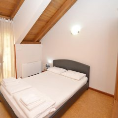 Апартаменты Tianis Apartments комната для гостей фото 3