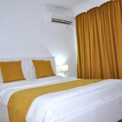 Отель Natea Apartments Албания, Тирана - отзывы, цены и фото номеров - забронировать отель Natea Apartments онлайн комната для гостей фото 2