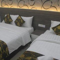 D'Metro Hotel 3* Стандартный семейный номер с двуспальной кроватью фото 3