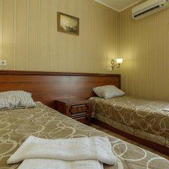 Mini-Hotel Tri Art Стандартный семейный номер с двуспальной кроватью