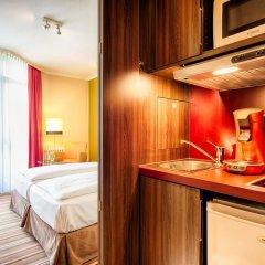Отель Leonardo Hotel & Residenz München Германия, Мюнхен - 11 отзывов об отеле, цены и фото номеров - забронировать отель Leonardo Hotel & Residenz München онлайн удобства в номере