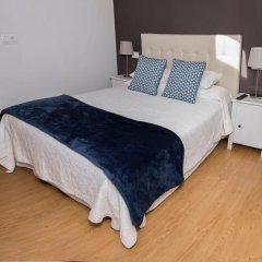 Апартаменты Apartments Llanes & Golf комната для гостей фото 3